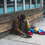 man-sitting-on-street